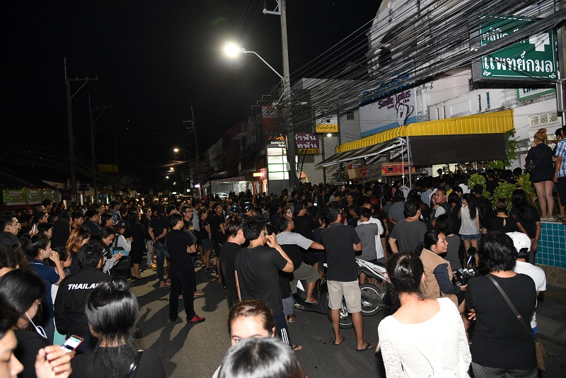 an angry mob gathered in front of a soy milk store in Phuket city demanding the shop owner's son be arrested for allegedly insulting the royal family.