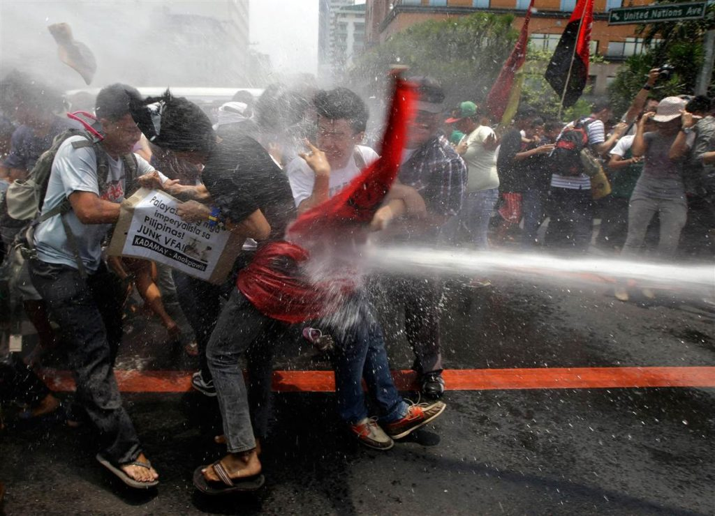 A firetruck doused the rowdy protesters with water to push them back,