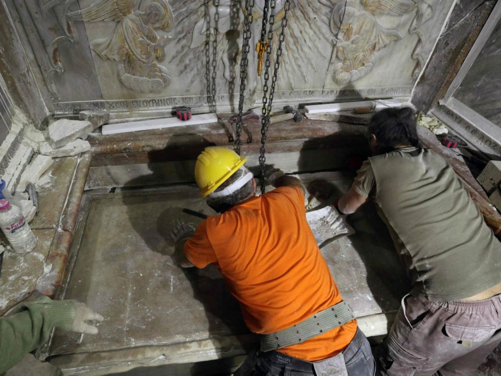 Greek preservation experts place back the marble slab stone that covered the Tomb of Jesus, where his body is believed to have been laid, after it was removed for 3 days to allow the team to do resto Gali Tibbon, AFP read more: http://www.haaretz.com/israel-news/.premium-1.749780