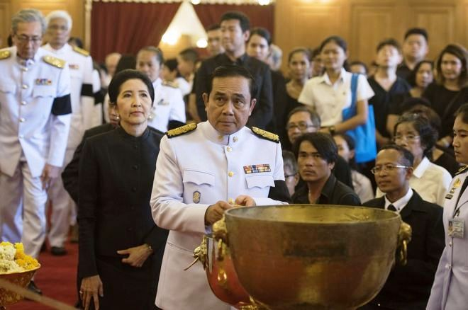 Thai Prime Minister General Prayuth Chan-o-cha attends the royal bathing ceremony - a funeral ritual - at The Grand Palace