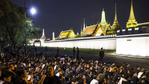 Thousands of black-clad mourners gathered at the Grand Palace