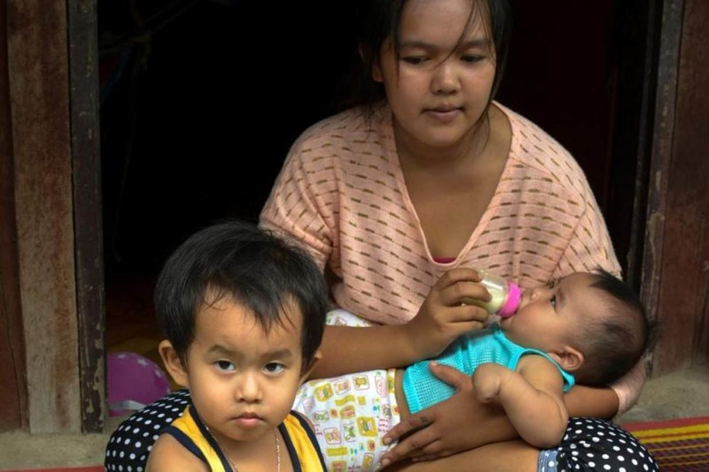 Narinthip Pommarin feeds her son during an interview with the Thomson Reuters Foundation at her home in Samut Songkhram, Thailand,