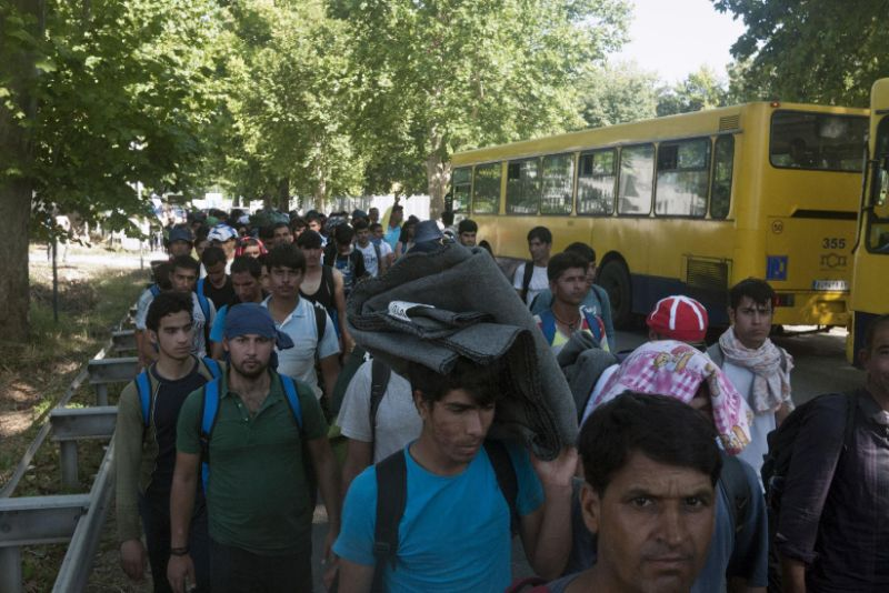 Migrants set off on foot on Tuesday toward Serbia's border with Hungary