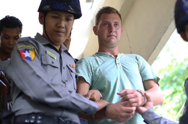 Klass Haytema being escorted by Burmese police after a court appearance