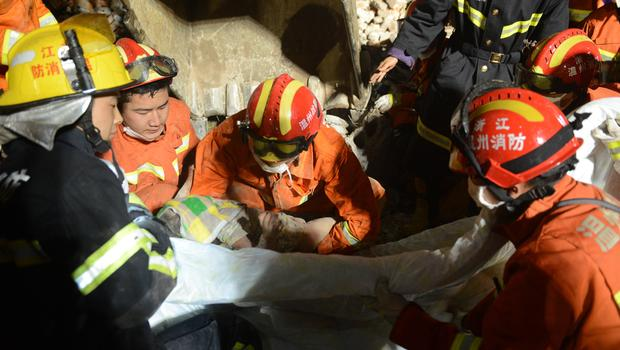 3-year-old Chinese Girl Survives Building Collapse in Arms of Her Dead Parents