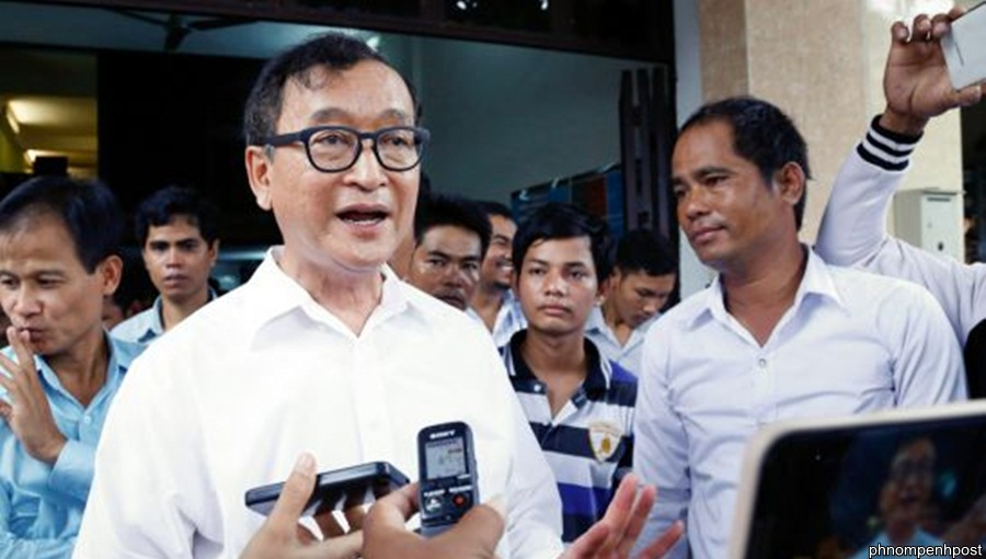 Cambodia's main opposition Cambodia National Rescue Party president Sam Rainsy speaks to the press