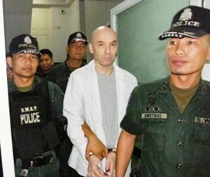 Canadian Michael Karas with Pattaya Police after being extraditied from Canada in 2011