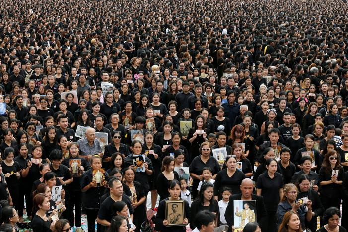 Mourners gather outside of the Grand Palace to sing for a recording of the royal anthem in honour of Thailand's late King Bhumibol Adulyadej, in Bangkok. - Photo Jorge Silva