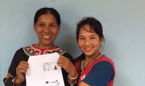 Single mother Manee, left, holds up a copy of her newly acquired Thai National ID Card, accompanied by her daughter, right, in Chiang Rai, Thailand.   © UNHCR Thailand