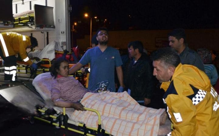 Medics carry a wounded student to an ambulance in Aladag, Adana in southern Turkey.