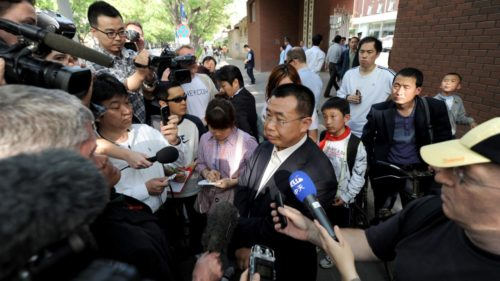 Journalists interview rights lawyer Jiang Tianyong in May of last year outside the hospital in Beijing.