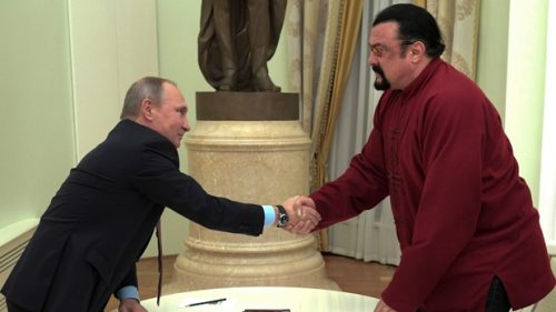Russian President Vladimir Putin shakes hands with U.S. actor Steven Seagal in the Kremlin in Moscow