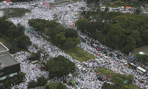 Tens of thousands of Muslims march during a rally against Jakarta's governor, Basuki 'Ahok' Tjahaja Purnama, calling for his prosecution for blasphemy - Photo Tatan Syuflana