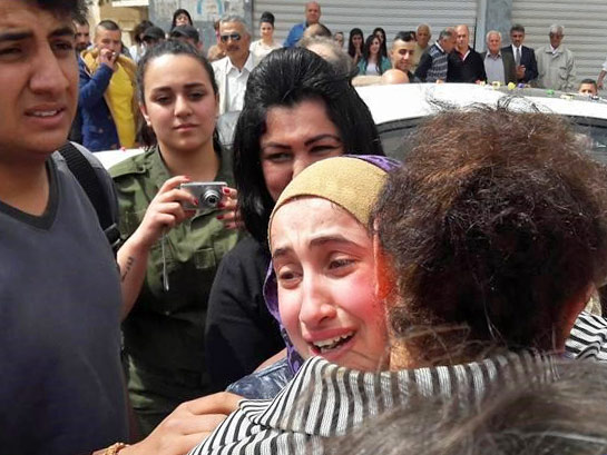 16-year-old Maryam David Talya falls into  the arms of her waiting parents in Hassakeh