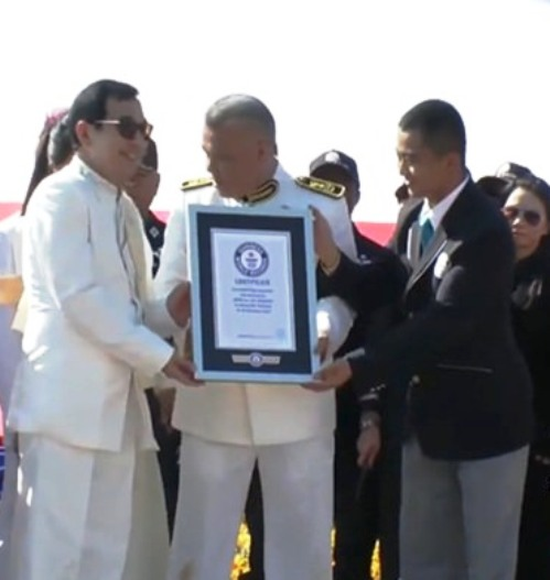 Guinness Book officials present the official certificate of Worlds Largest Flying Thai Flag