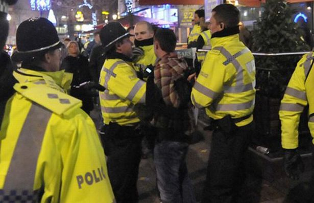 Surrey England Rings in Christmas Morning with 100 Person Street Brawl