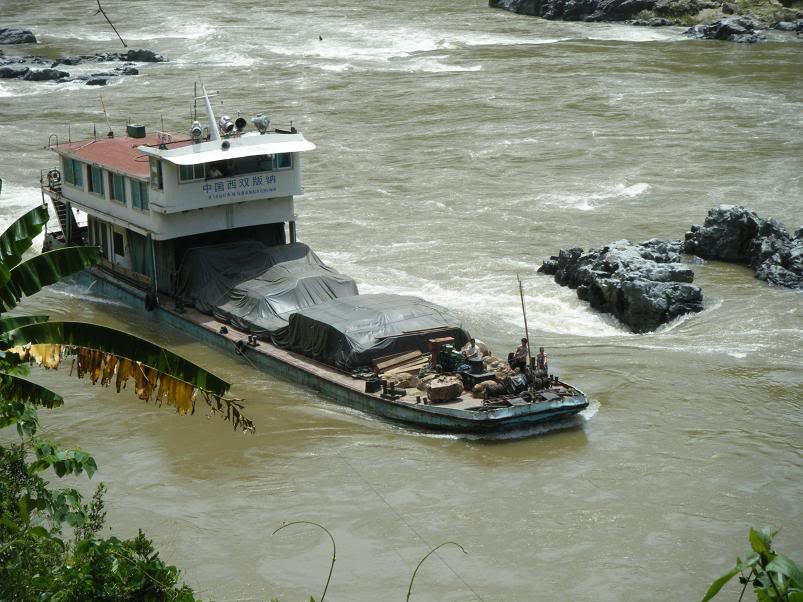 Chinese freighter navigates the lower mekong during the dry season in Thailand