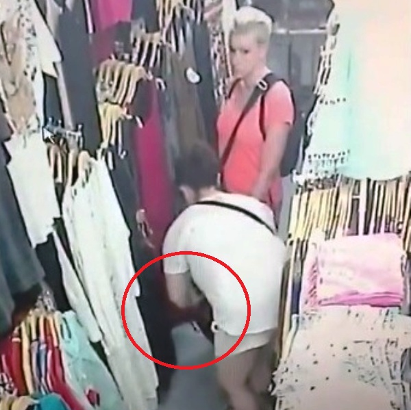 CCTV Camera Captures two foreign woman stealing a white laced shirt from Thai clothing shop