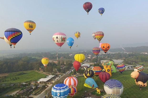 Love was Litterally in the Air as Couples Exchange Vows in Hot-Air Balloons at Chiang Rai's Singha Park