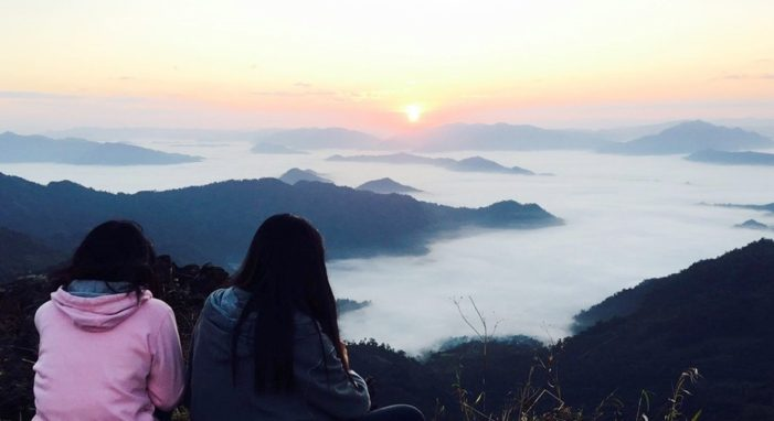 Tourists Flock to Watch the Sun Rise Over the Sea of Fog at Phu Chi Fah
