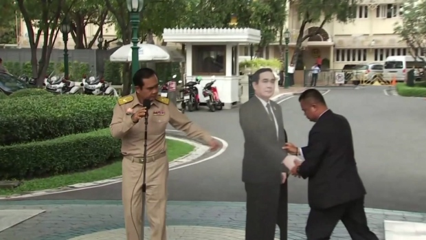 """News Footage of Thai PM Telling Reporters to """"Talk To His Cardboard Cut-Out Goes Global"""