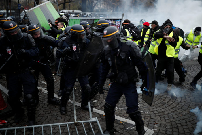 Riots Erupt in Paris Over President Emmanuel Macron's Gas Tax and Socialist Policies