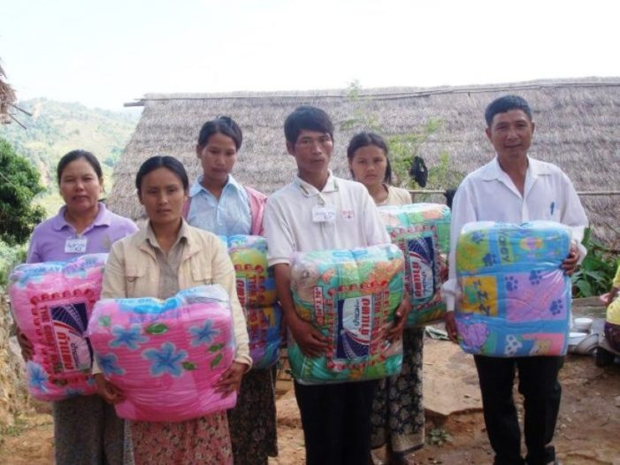 Thai Official Distribute Blankets and Medicine to Villagers in Mae Fah Luang District