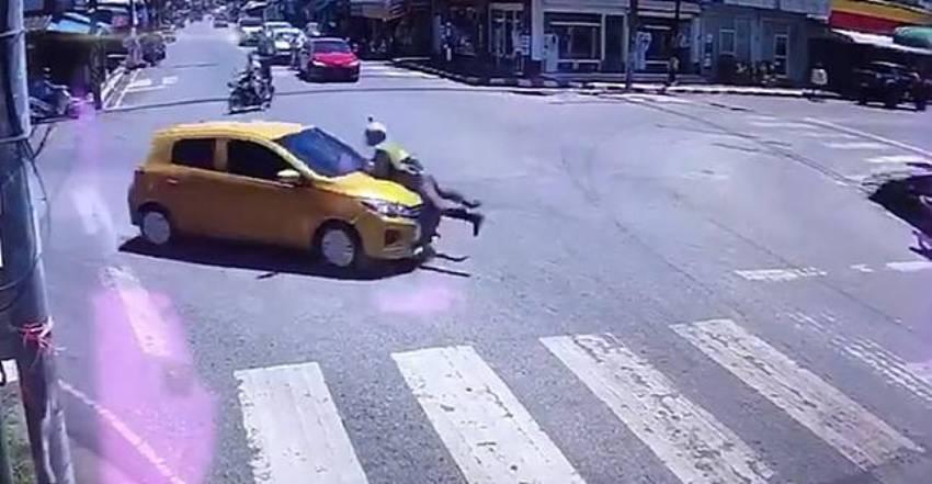 police man on mitsubishi hood