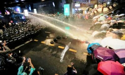 Riot Police Fire Water Canons at Anti-Government Protesters in Bangkok