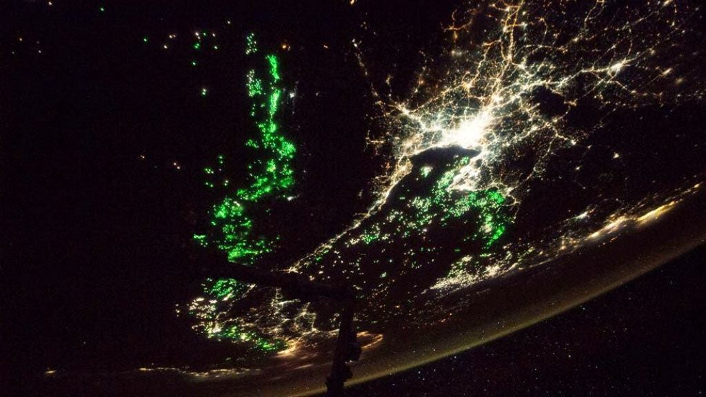 Eerie Green Lights Seen from Space Station