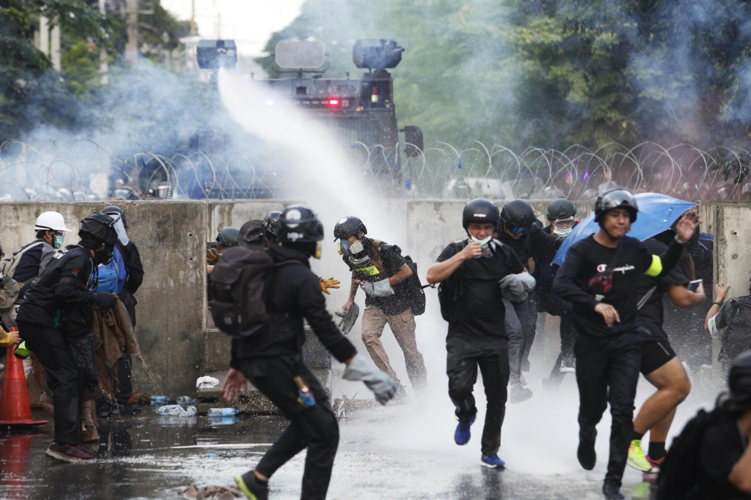 Thai Police and Anti-Government Protesters Clash Outside of Parliament