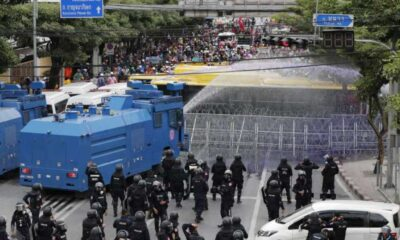 Thai Politicians Flee Parliament as Protesters Clash with Thai Police