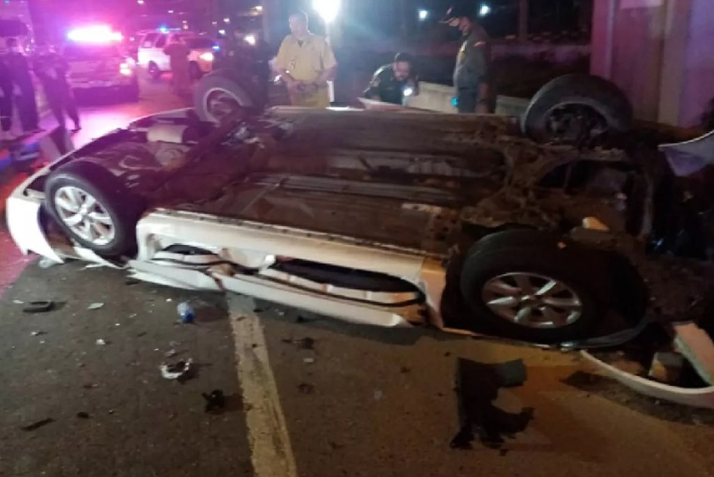 Man Killed After Car Crashes into Barrier and Topples Off Expressway