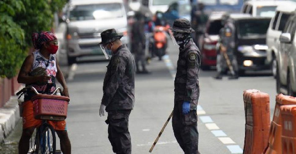 Philippine Police Threaten to Cane Covid-19 Rule Violators