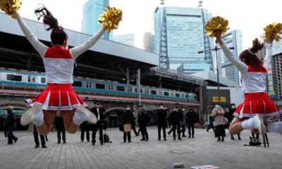 Japanese Cheerleaders Lift Spirits in Tokyo Ahead of Covid-19 lockdown