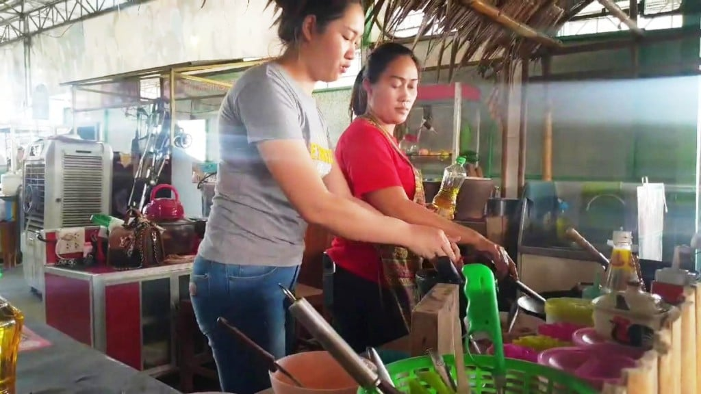 Noodle Shop Vendor Says Life is Good With Two Wives