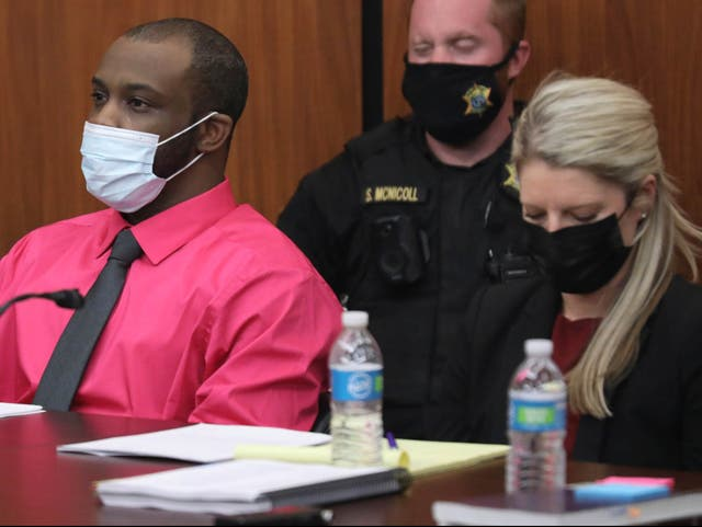Defendant Nathaniel Rowland sits with his attorney Alicia Goode during closing arguments in his trial on Tuesday 27 July 2021