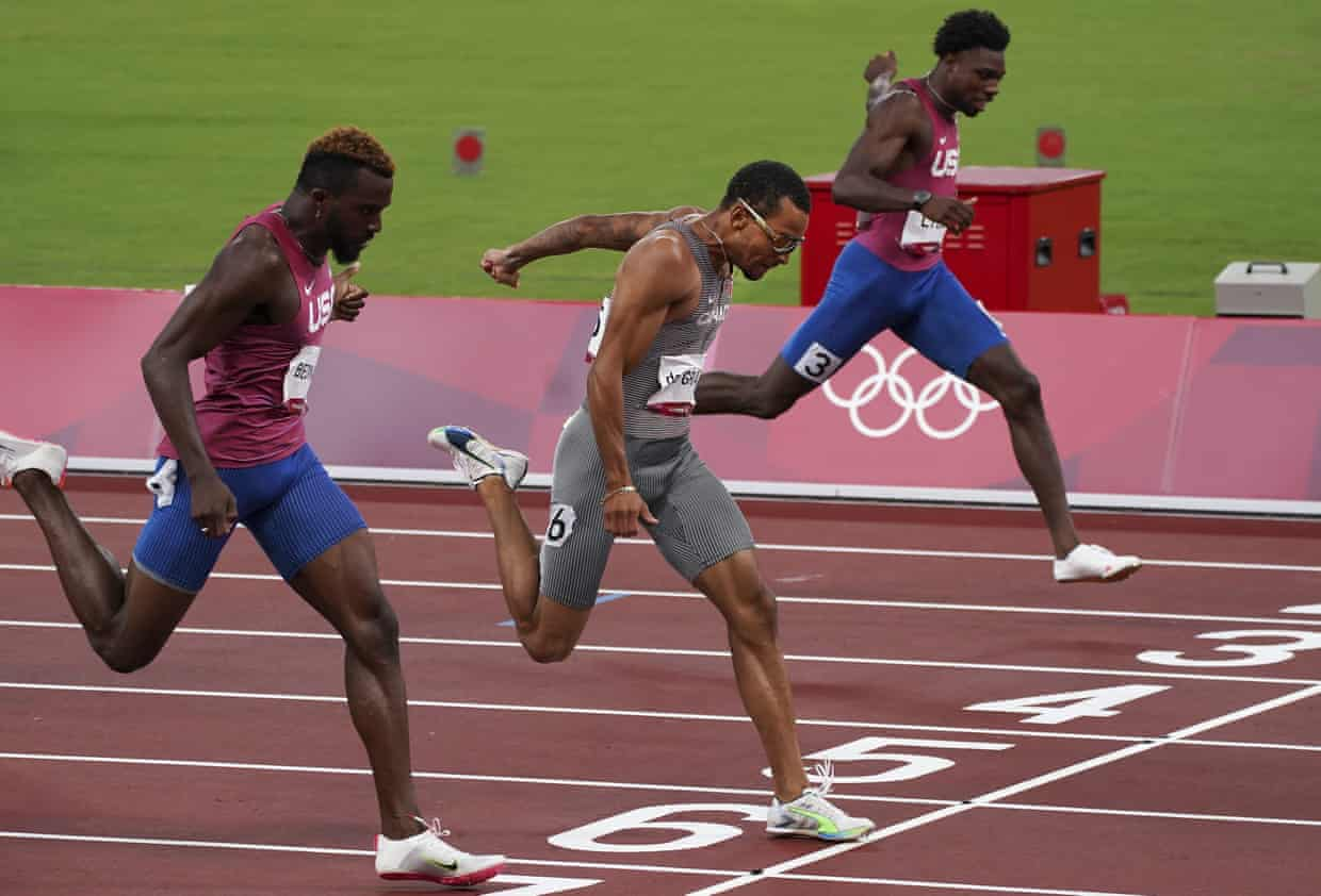 Andre De Grasse (centre) takes victory ahead of Kenny Bednarek (left) and pre-Games favourite Noah Lyles