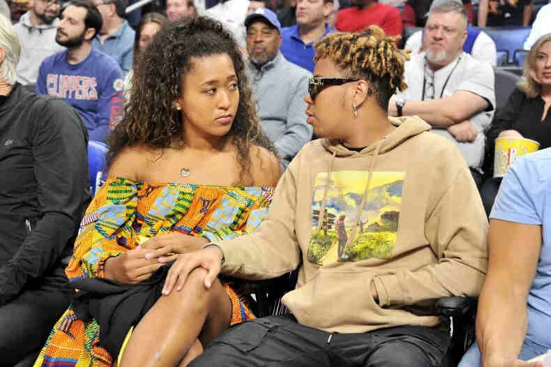Naomi Osaka and boyfriend YBN Cordae attend a basketball game between the Los Angeles Clippers and the Washington Wizards at Staples Center on December 1, 2019 in Los Angeles, California.