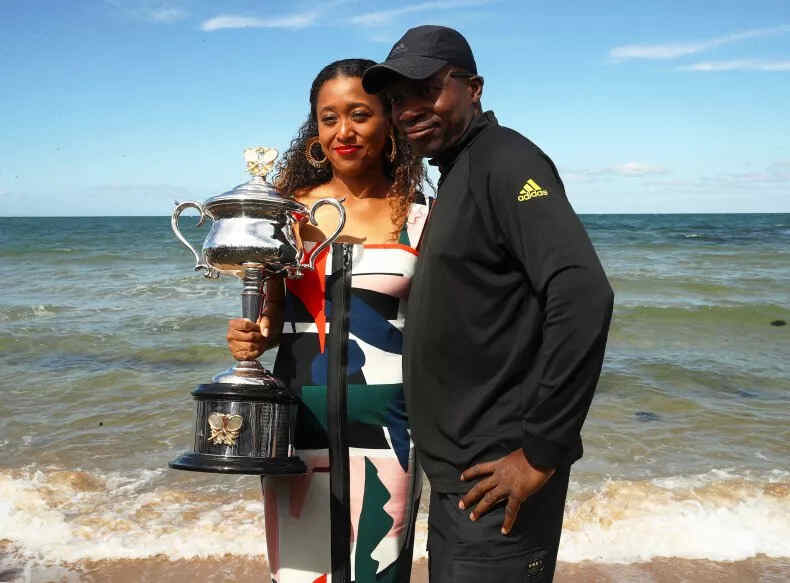 Naomi's father Leonard Francois Osaka posing with the Daphne Akhurst Memorial Cup during the Women's Australian Open in Melbourne, Australia.