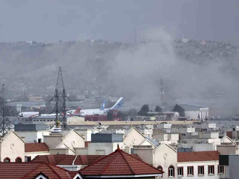 Smoke rises from an explosion outside the airport in Kabul. Gunfire and at least one other bombing has taken place across the Afghan capital on Thursday.
