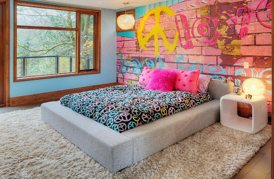 Bedroom offers a cool and eclectic look thanks to the graffiti wall